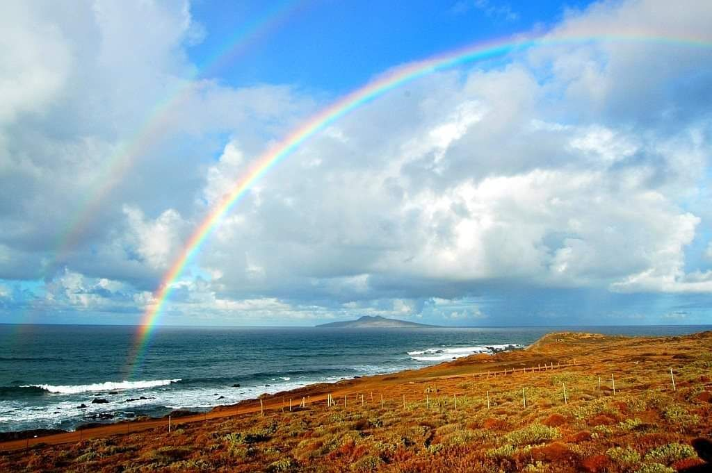 author: Ron Gomez Hoff;desc: Triple Rainbow;location: San Martin Island, La Chorera, Ensenada, Mexico;